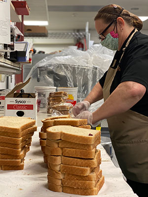 Making sandwiches with King Arthur bread donations during Covid-19.